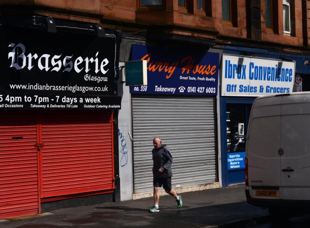 """GV showing Curry House on Glasgow's Paisley Road West where 17 different takeaways have been hit with food hygiene warnings, MAY 02 2016 See SWNS story SWDIRTY; This city centre street could be the most dangerous place in Britain to get a takeaway - after 17 fast food joints were hit with food hygiene warnings. Environmental health chiefs have swooped on a series of Indian, Italian, Chinese and Turkish takeaways on Glasgow's Paisley Road West in the past year. Now the three-and-a-half mile stretch of road is in the running for the dubious honour of most risky place in Britain to buy a bag of chips. A dozen of the takeaways were slapped with """"improvement required"""" notices last year and a further five premises have had them issued so far this year."""