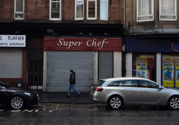 """GV showing Super Chef on Glasgow's Paisley Road West where 17 different takeaways have been hit with food hygiene warnings, MAY 02 2016 See SWNS story SWDIRTY; This city centre street could be the most dangerous place in Britain to get a takeaway - after 17 fast food joints were hit with food hygiene warnings. Environmental health chiefs have swooped on a series of Indian, Italian, Chinese and Turkish takeaways on Glasgow's Paisley Road West in the past year. Now the three-and-a-half mile stretch of road is in the running for the dubious honour of most risky place in Britain to buy a bag of chips. A dozen of the takeaways were slapped with """"improvement required"""" notices last year and a further five premises have had them issued so far this year."""