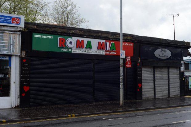 """GV showing Roma Mia on Glasgow's Paisley Road West where 17 different takeaways have been hit with food hygiene warnings, MAY 02 2016 See SWNS story SWDIRTY; This city centre street could be the most dangerous place in Britain to get a takeaway - after 17 fast food joints were hit with food hygiene warnings. Environmental health chiefs have swooped on a series of Indian, Italian, Chinese and Turkish takeaways on Glasgow's Paisley Road West in the past year. Now the three-and-a-half mile stretch of road is in the running for the dubious honour of most risky place in Britain to buy a bag of chips. A dozen of the takeaways were slapped with """"improvement required"""" notices last year and a further five premises have had them issued so far this year."""