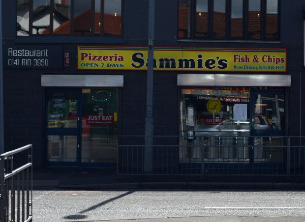 """GV showing Sammie's on Glasgow's Paisley Road West where 17 different takeaways have been hit with food hygiene warnings, MAY 02 2016 See SWNS story SWDIRTY; This city centre street could be the most dangerous place in Britain to get a takeaway - after 17 fast food joints were hit with food hygiene warnings. Environmental health chiefs have swooped on a series of Indian, Italian, Chinese and Turkish takeaways on Glasgow's Paisley Road West in the past year. Now the three-and-a-half mile stretch of road is in the running for the dubious honour of most risky place in Britain to buy a bag of chips. A dozen of the takeaways were slapped with """"improvement required"""" notices last year and a further five premises have had them issued so far this year."""