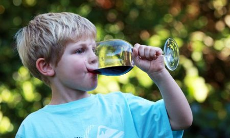 Kid drinking wine