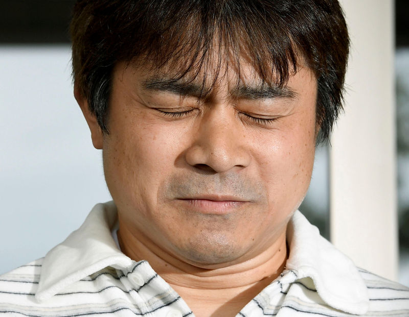 Takayuki Tanooka, father of 7-year-old boy Yamato Tanooka who went missing on May 28, 2016 after being left behind by his parents, was found alive, reacts as he speaks to the media in Hakodate