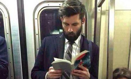 Man Reading On Tube
