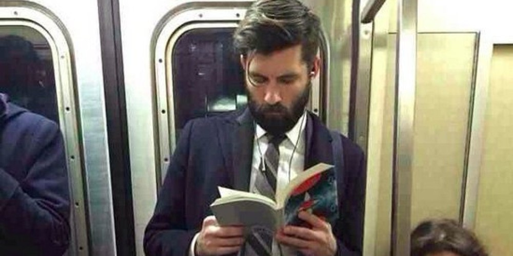 Man Reading On Tube