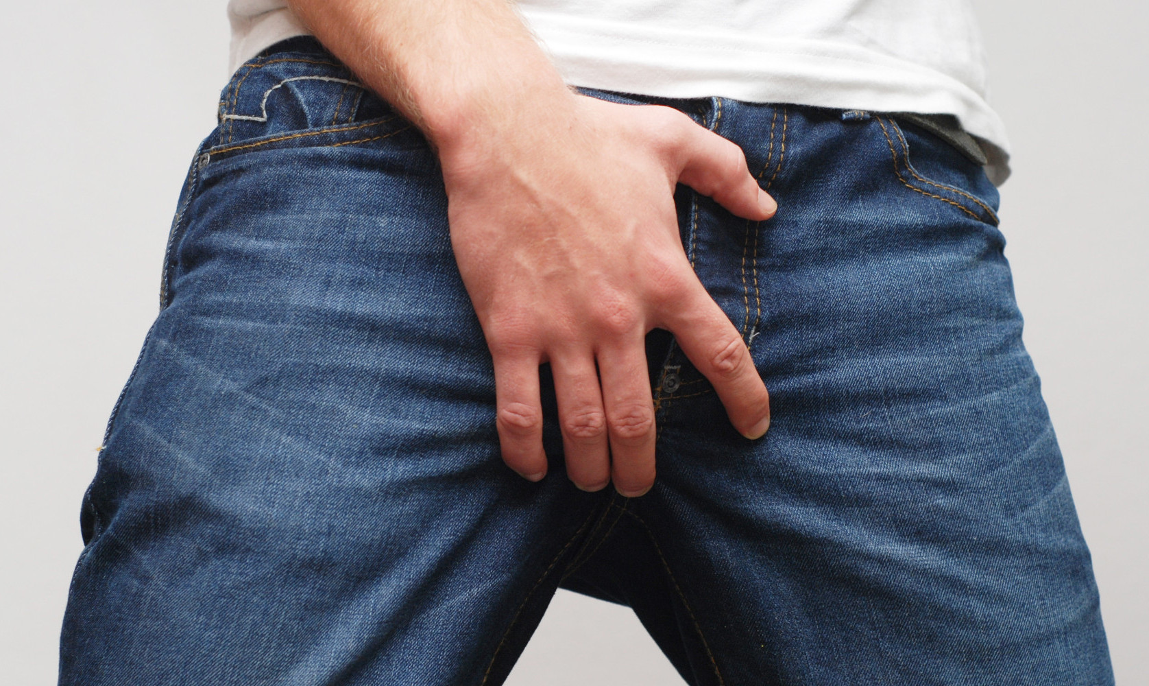 Man scratching crotch