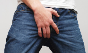 Man scratching crotch