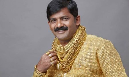 "GOLD MINGER  Wealthy Datta Phuge has splashed out 14,000 GBP on a solid gold shirt to make sure he's a 24 karat hit with women in central India.  Money-lender Datta, 32, from Pimpri-Chinchwad, says the shirt took a team of 15 goldsmiths two weeks to make working 16 hours a day creating and weaving the gold threads.  It comes complete with its own matching cuffs and a set of rings crafted from left-over gold.  ""I know I am not the best looking man in the world but surely no woman could fail to be dazzled by this shirt?"" he explained.  (ends)"