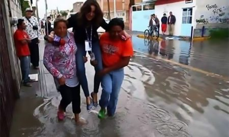 "Pic shows: the picture that got Lydia Cumming sacked;nnA young female Mexican journalist who turned up in a flood hit disaster zone with posh shoes has been sacked after being photographed being carried by two locals over puddles.nnLydia Cumming used to work for TV Azteca in the central city of Puebla.nnThe journalist was sent to cover the story of floods that took place in the southern area of the state of Puebla.nnBut she ended up becoming the news when she was photographed being carried by two locals ¿ a woman and a man ¿ so she did not get her feet wet in puddles.nnEach person holds one leg of the reporter as she keeps the mic in her right hand and the press pass attached to her neck.nnAfter the photo got published on Twitter, many Mexican users were outraged and claimed this was a lack of professionalism. The hashtag #LadyReportera (Miss Reporter) soon went viral.nn@jodherlo: #LadyReportera is Lydia Cumming from TV Azteca Puebla. She asked to be carried so she would not get wet""nn@Capitan_Oski: ""What a total lack of professionalism. She should be fired for this.""nnJuan Carlos Valerio, a local TV host and one of the TV Azteca Puebla bosses, announced in a tweet that Lydia Cumming was sacked. He said on Tuesday: ""She was fired yesterday. I¿m sorry for what happened.""nn""Her attitude is regrettable and for this we sacked her.""nnInternet users created funny picture memes of the incident.nnOne of them shows the three people recreating a famous publicity stunt of Silvester Stallone sitting on two reversing trucks. Another one puts Lydia Cumming in a famous photo of the lunar mission. Another user placed the scene in a Star Wars movie screenshot.nnThe reporter who got sacked later apologized using social media.nnShe said: ""The images show lack of professionalism""nnShe apologized to ""anyone who felt affected by the situation."""