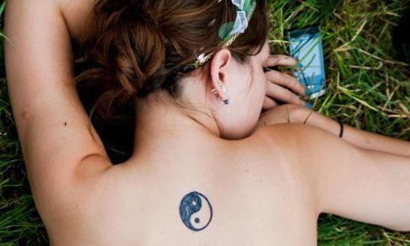 E76KEA Overhead shot of a young womans yin yang tattoo