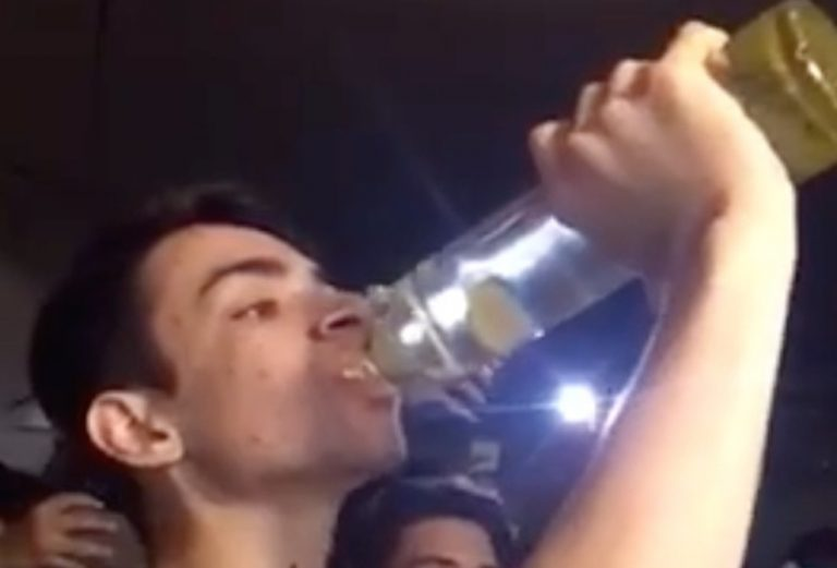 guy-chugs-bottle-of-vodka