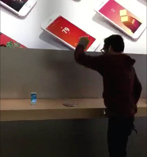 Man smashing iPhones