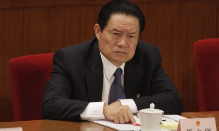 CHINA - MARCH 08:  Zhou Yongkang, member of the Standing Committee of the Political Bureau of the Chinese Communist Party (CCP) Central Committee, attends the second plenary session of China's 11th National People's Congress (NPC) in Beijing, China, on Saturday, March 8, 2008. China's National People's Congress will install the likely successors to President Hu Jintao and Premier Wen Jiabao as it meets in Beijing.  (Photo by Nelson Ching/Bloomberg via Getty Images)