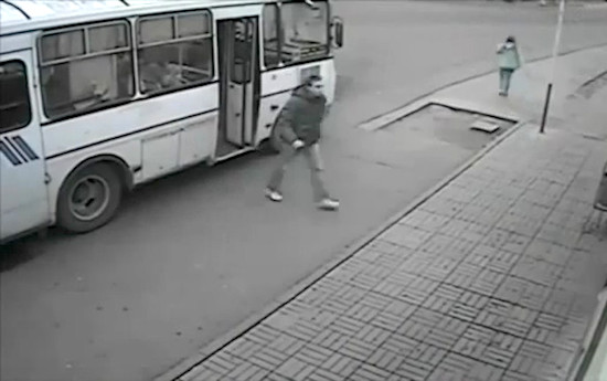 guy-jumps-off-bus