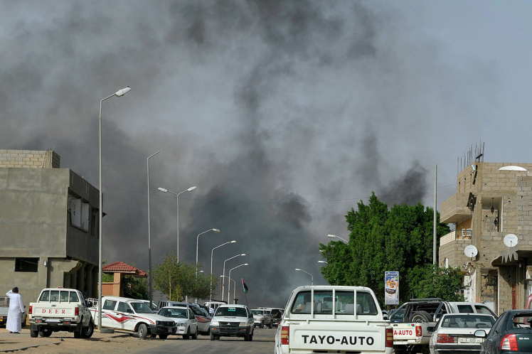 Smoke rises from a road in the district