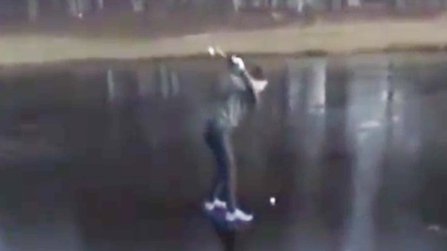 death wish golfer tries to hit ball off frozen pond immediately