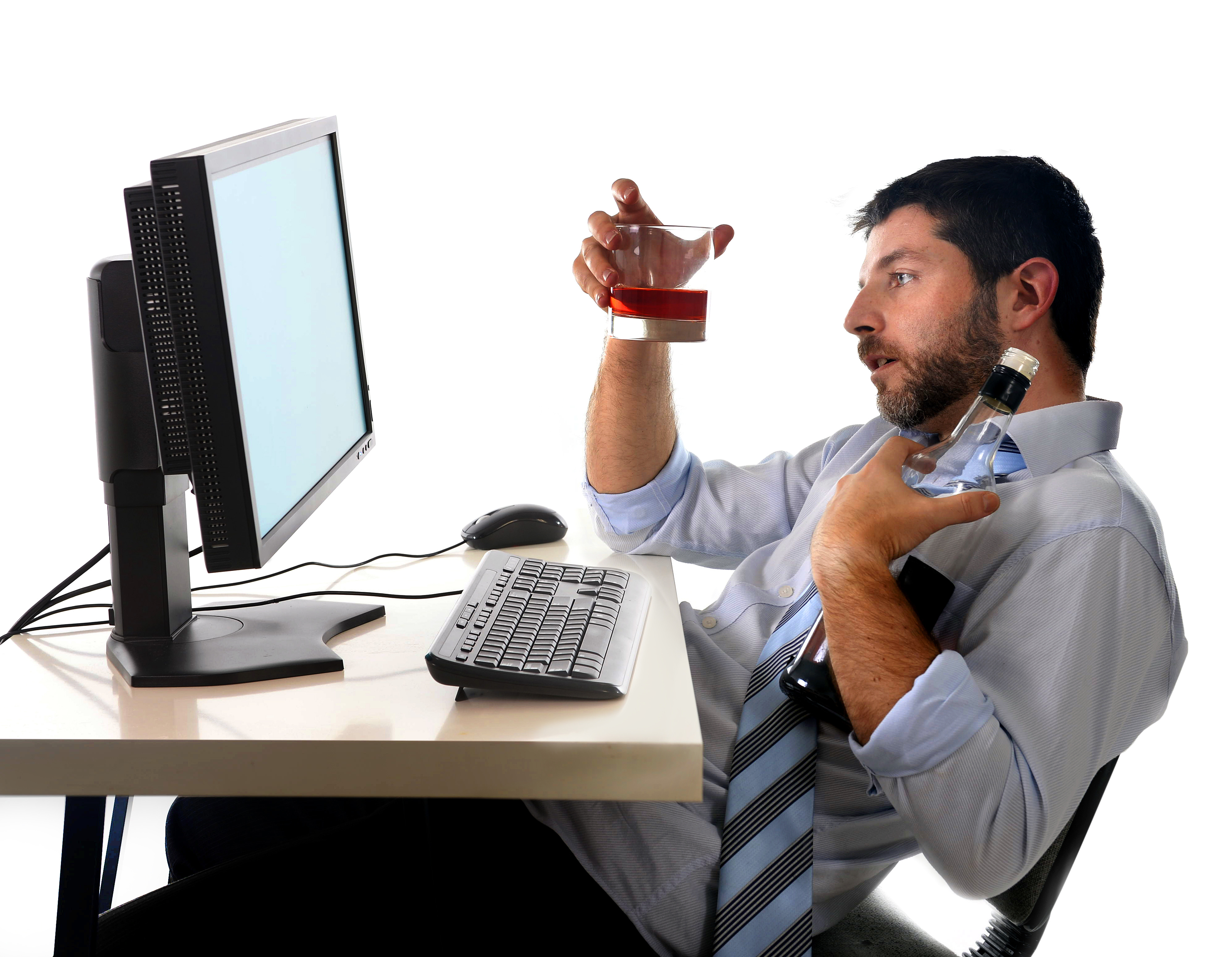 alcoholic business man sitting drunk at office with computer