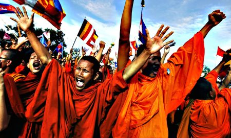 Buddhist monks who are supporters of the CNRP react as party leader Sam Rainsy announces the result of a meeting with Cambodian PM Hun Sen in Phnom Penh...Buddhist monks who are supporters of the Cambodia National Rescue Party (CNRP), react during a protest as party leader Sam Rainsy announces the result of a meeting with Cambodian Prime Minister Hun Sen, at Freedom Park in Phnom Penh September 16, 2013. Hun Sen met opposition leader Sam Rainsy for talks and officials said they had agreed to look at how future general elections are held but the long-serving premier refused to give in to demands for an independent inquiry into the July 28 poll. The protest was staged a day after police used force to scatter protesters challenging a disputed election win by Hun Sen, sparking clashes in which one man was shot dead. REUTERS/Athit Perawongmetha (CAMBODIA - Tags: RELIGION CIVIL UNREST POLITICS TPX IMAGES OF THE DAY)