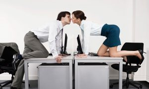 Office workers kissing