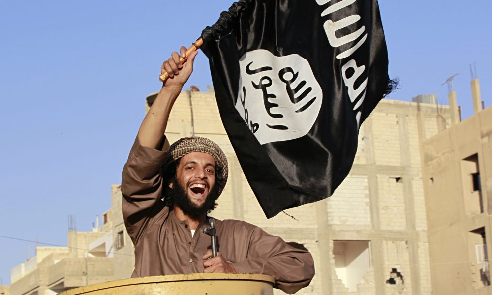 An Isis fighter takes part in a military parade
