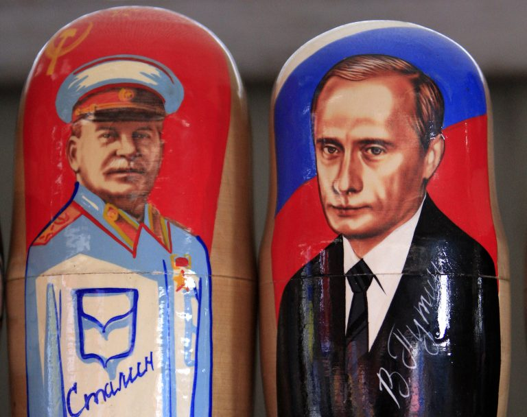 Traditional Matryoshka dolls or Russian nesting dolls bearing the faces of Russia's president elect and current Prime Minister Vladimir Putin and former Soviet dictator Josef Stalin are seen in a souvenir shop in Kiev March 5, 2012.    REUTERS/Stringer (UKRAINE  - Tags: SOCIETY)