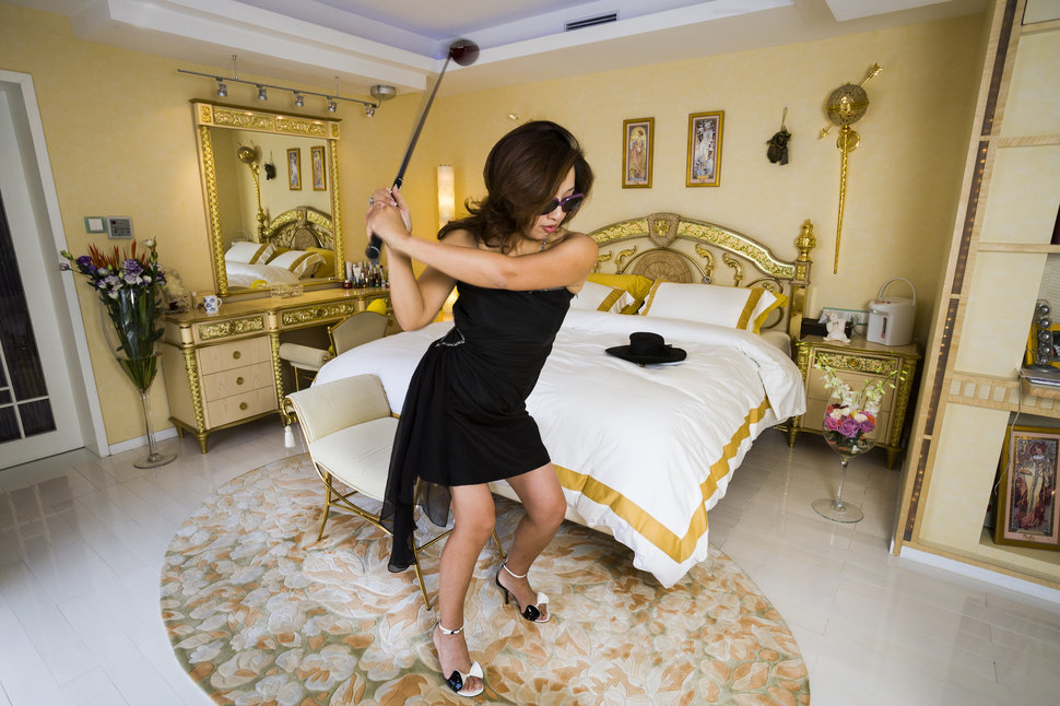 Xue Qiwen, 43, in her Shanghai apartment, decorated with furniture from her favorite brand, Versace, 2005.
