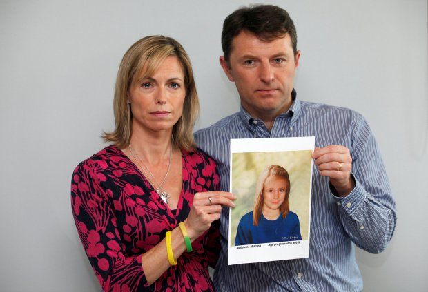 FILE PHOTO - Kate and Gerry McCann pose with a computer generated image of how their missing daughter Madeleine might look now, during a news conference in London