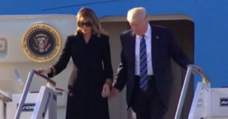 Melania Trump hold hand