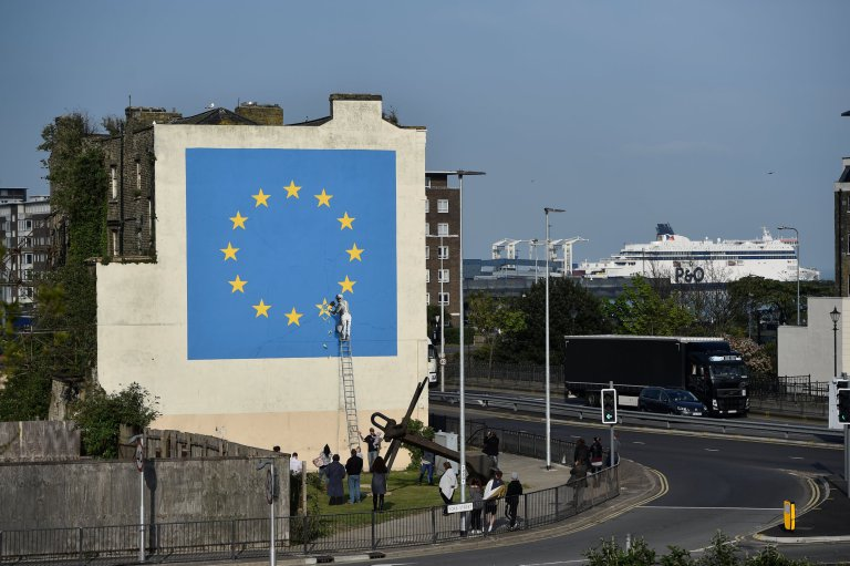 An artwork attributed to street artist Banksy, depicting a workman chipping away at one of the 12 stars on the flag of the European Union, is seen on a wall in the ferry port of Dover, Britain May 7, 2017. REUTERS/Hannah McKay FOR EDITORIAL USE ONLY. NO RESALES. NO ARCHIVES.