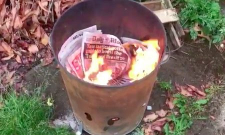 Burning newspapers