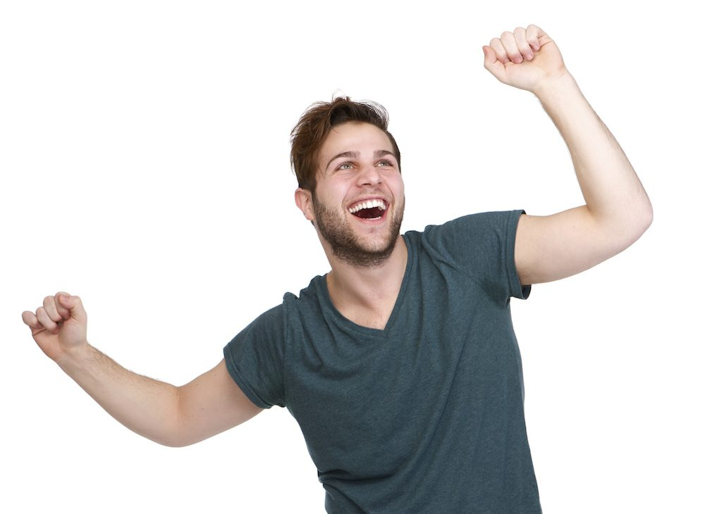 man cheering with arms outstretched