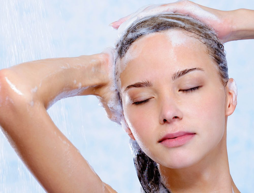 Relaxation of woman taking shower