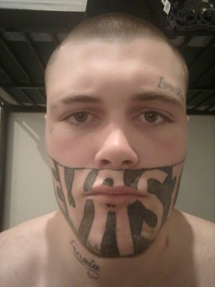 guy with tattoos on face