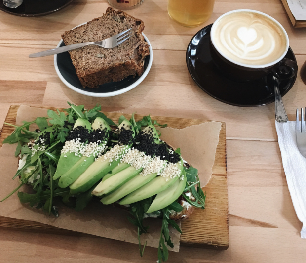 Avocado slice with cake and coffee