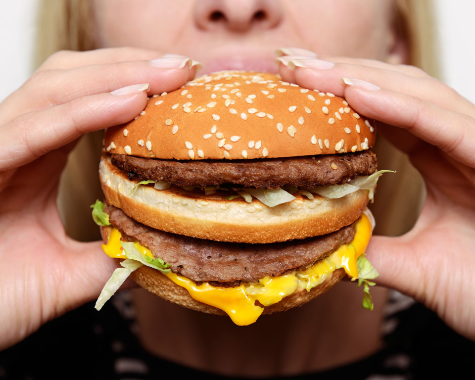 Woman eating big mac