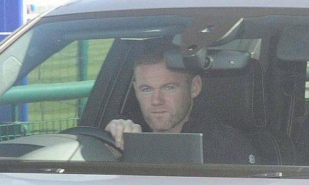 Wayne Rooney driving