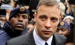 FILE PHOTO: Olympic and Paralympic track star Oscar Pistorius leaves court after appearing for the 2013 killing of his girlfriend Reeva Steenkamp