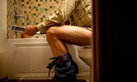 Man-sitting-on-toilet