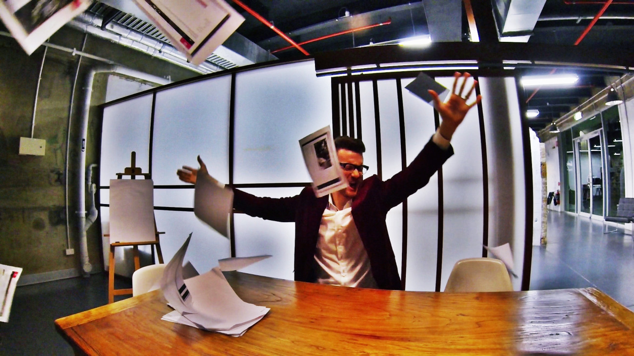 Business man throwing paperwork in frustration