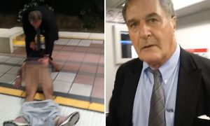 White MAn Drags Black Man Off Train