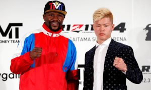 Boxer Floyd Mayweather Jr. of the U.S. poses for a photograph with his opponent Tenshin Nasukawa during a news conference in Tokyo